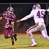 (Brad Davis/The Register-Herald) Woodrow Wilson quarterback Peyton Shehan dodges George Washington pass rusher Arpan Kumar as he moves from the pocket Friday night in Beckley.