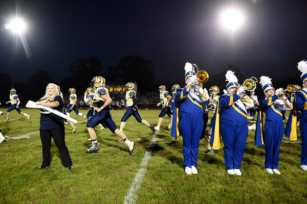 Shady Spring's football team runs out onto the field during their high school football game against Wyoming East Friday in Shady Spring. (Chris Jackson/The Register-Herald)