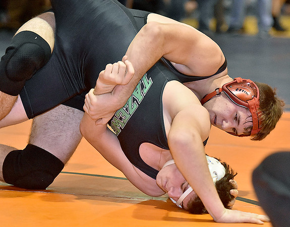 (Brad Davis/The Register-Herald) PikeView's Tyler Tiller, top, takes on Tazwell's Marcus Sluss in a 170-pound weight class matchup Saturday afternoon at the Summersville Arena and Convention Center. PikeView's Tiller would win the match.