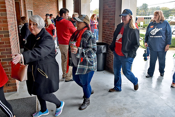 (Brad Davis/The Register-Herald) Fayette County teachers make their way into the Soldiers & Sailors Memorial building to cast early votes Saturday morning in Fayetteville.