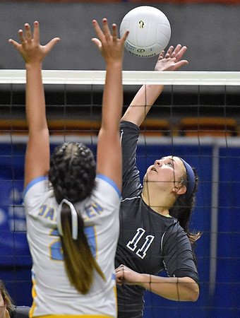 (Brad Davis/The Register-Herald) Independence's Ashleigh Sexton spikes the ball as Oak Glen's Jaedyn Hissam tries to block it during State Volleyball Tournament action Friday morning at the Charleston Civic Center.
