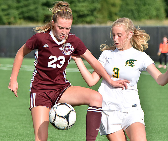 (Brad Davis/The Register-Herald) Woodrow Wilson's Hattie Hall battles for possession with Greenbrier East's Hallie Grimm Friday evening at the YMCA Paul Cline Memorial Soccer Complex.