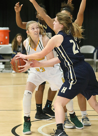(Brad Davis/The Register-Herald) Greenbrier East's Haley McClure battles underneath as Hedgesville's Serenity McDill defends during Big Atlantic Classic action Thursday night at the Beckley-Raleigh County Convention Center.