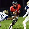 Oak Hill ball carrier, Abraham Farrow, tries to get through the line of scrimage but is met by Shady Spring's Daylin Toms (45) and Justin Black (4). Chad Foreman for the Register-Herald.