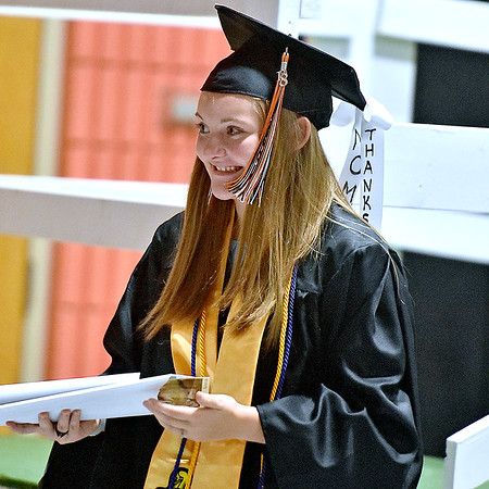 "(Brad Davis/The Register-Herald) Sporting a ribbon that reads ""Thanks Mom,"" graduating Summers County senior Tiffani Cline smiles towards friends and family in the stands after receiving her diploma during the school's 2018 Commencement Ceremony Friday evening in Hinton."