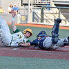 (Brad Davis/The Register-Herald) Miners baserunner Dalton Davis tries to score from 1st base off teammate Jonathan Pasillas's 4th-inning double but can't avoid the tag of Chillicothe catcher Michael Ryan as he'd be called out on the play Saturday evening at Linda K. Epling Stadium.