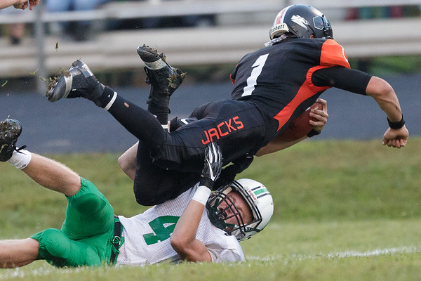 Richwood Lumberjack, Caleb Jantuah runs over Eli Selvey to get a couple more yards and a first down. Chad Foreman for the Register-Herald.