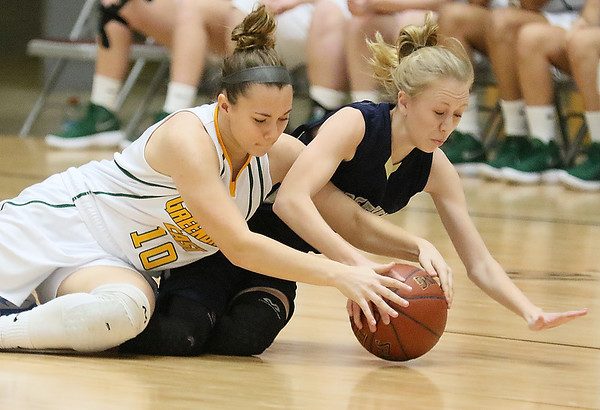 (Brad Davis/The Register-Herald) Greenbrier East's Abby Bartenslager dives for a loose ball with Hedgesville's Meghan Kerns during Big Atlantic Classic action Thursday night at the Beckley-Raleigh County Convention Center.