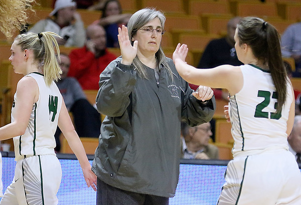 (Brad Davis/The Register-Herald) Wyoming East head coach Angie Boninsegna high fives her players as they head to the bench during a timeout in the Lady Warriors' opening round State Basketball Tournament Game against Lincoln Wednesday afternoon at the Charleston Civic Center.