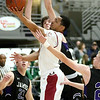 (Brad Davis/The Register-Herald) Bluefield's Mookie Collier drives and scores as James Monroe's McKinley Mann defends during Big Atlantic Classic action Thursday night at the Beckley-Raleigh County Convention Center.