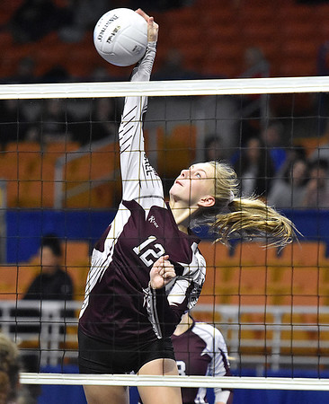 (Brad Davis/The Register-Herald) Woodrow Wilson's Emily Stack spikes the ball against University during State Volleyball Tournament action Friday evening at the Charleston Civic Center.