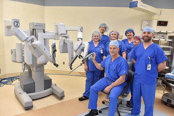 "(Brad Davis/The Register-Herald) Dr. Scott Killmer, a surgeon at Raleigh General Hospital, poses for a quick photo with his team of assistants wo use the da Vinci robotic surgical system, a.k.a. ""The Robot"" during a Register-Herald visit to the hospital Friday afternoon. He just completed his 500th surgery using the da Vinci system."