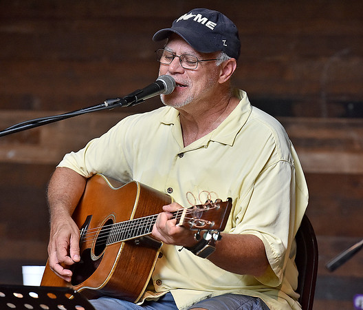 (Brad Davis/The Register-Herald) Lewisburg musician Jim Snyder performs during a day of tunes and hanging out at the Chimney Corner Cafe & Amphitheater Sunday afternoon near Ansted.