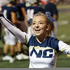 A Nicholas County Cheerleader gets the crowd excited after the Grizzly's score a touchdown. Chad Foreman for the Register-Herald.