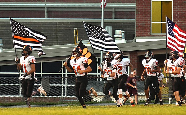 Summers Co. enters the field with flags at Greenbrier West High School in Charmco.<br /> Rick Barbero/The Register-Herald)