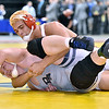 (Brad Davis/The Register-Herald) Oak Hill's Christian Lively takes on Berkeley Springs' Tanner Clark for the class AA/A 220-pound weight class championship during State Wrestling Tournament action Saturday night at the Big Sandy Arena.