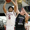 (Brad Davis/The Register-Herald) Bluefield's Russell Blevins drives and scores as James Monroe's Brady Davis defends during Big Atlantic Classic action Thursday night at the Beckley-Raleigh County Convention Center.