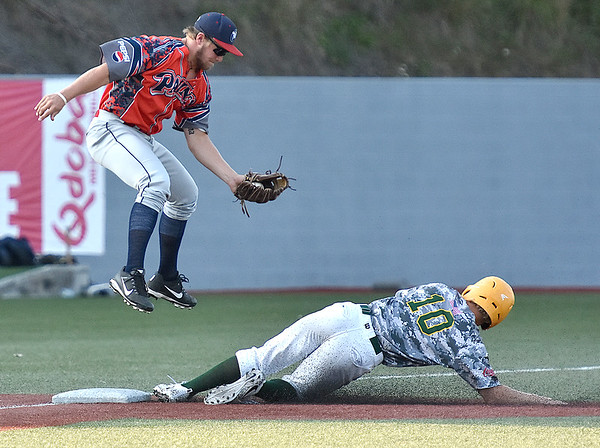 (Brad Davis/The Register-Herald) Miners baserunner Maddux Houghton slides into 3rd for a steal as Chillicothe infielder Trace Hatfield comes down after leaping to catch the high throw Friday night at Linda K. Epling Stadium.