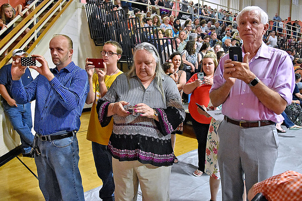 (Brad Davis/The Register-Herald) Family members use smartphones to capture the moments of Summers County High School's graduation ceremony Friday evening in Hinton.