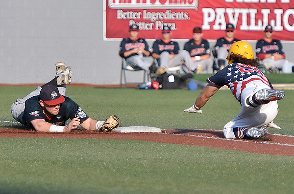(Brad Davis/The Register-Herald) Miners hitter Mike Santaromita dives as he tries to reach 1st but can't get there before Chillicothe infielder Andrew Czech forces him out Saturday night at Linda K. Epling Stadium.