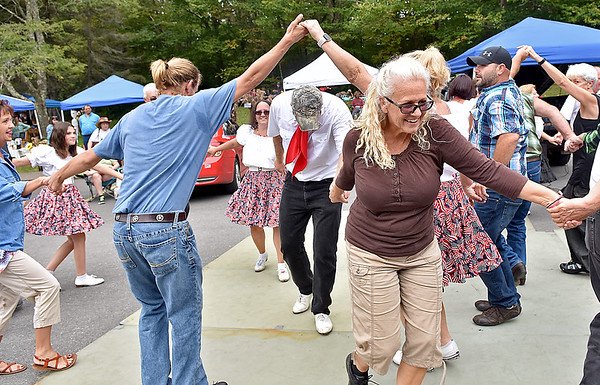 (Brad Davis/The Register-Herald) Regular folks in attendance join in with the professionals during a mass clog dance during the 31st Annual Cranberry Shindig Sunday afternoon at the Cranberry Nature Center in Hillsboro.