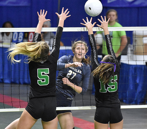 (Brad Davis/The Register-Herald) Nicholas County's Anna Hamilton rips a spike past Winfield's Jordan Signorelli, right, and Jaedyn Ball during State Volleyball Tournament action Friday afternoon at the Charleston Civic Center.