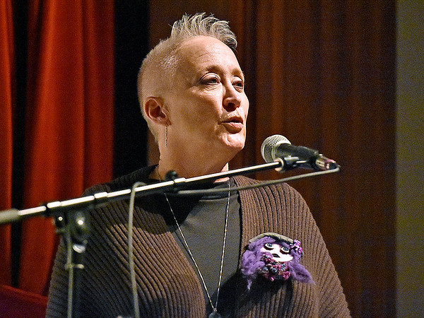 (Brad Davis/The Register-Herald) The Women's Resource Center's Patricia Bailey speaks during their 28th Annual Candlelight Vigil Thursday night inside The Raleigh Playhouse & Theatre.