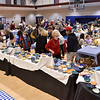 (Brad Davis/The Register-Herald) Attendees browse hundreds of handmade bowls during Beckley Quota Club's annual Empty Bowls fundrasing event Saturday afternoon inside The Place at United Methodist Temple.