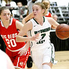 (Brad Davis/The Register-Herald) Wyoming East's Kara Sandy drives to the basket as Parkersburg's Aleea Crites defends during Big Atlantic Classic action Wednesday night at the Beckley-Raleigh County Convention Center.