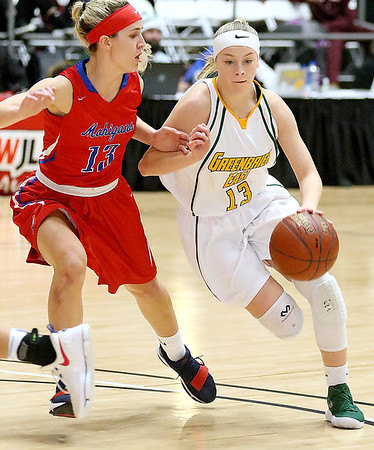 (Brad Davis/The Register-Herald) Greenbrier East's Autumn Hill drives to the basket as Morgantown's Aleena McDaniel defends during Big Atlantic Classic action Saturday the Beckley-Raleigh County Convention Center.