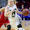 (Brad Davis/The Register-Herald) Wyoming East's Jazz Blankenship drives around Wayne's Whitney Sansom Friday morning at the Charleston Civic Center.