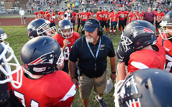 Independence head football coach John Lilly talks to his team after the first quarter against Midland Trail Friday night at Independence High School.<br /> Rick Barbero/The Register-Herald)