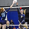 (Brad Davis/The Register-Herald) Shady Spring's Olivia Barnett rushes in to tap the ball back over as Philip Barbour's Jyra Clark Casto tries to block during State Volleyball Tournament action Friday evening at the Charleston Civic Center.
