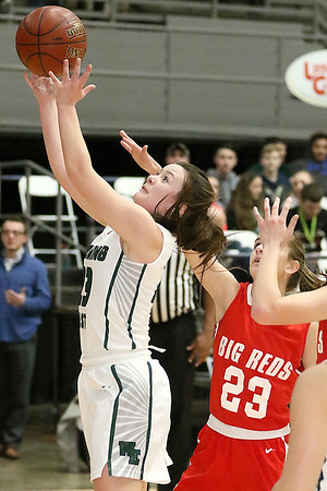 (Brad Davis/The Register-Herald) Wyoming East's Katy Daniels drives to the basket as Parkersburg's Emily Kupfner defends during Big Atlantic Classic action Wednesday night at the Beckley-Raleigh County Convention Center.
