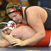 (Brad Davis/The Register-Herald) PikeView's Trey White takes on Herbert Hoover's Jacob Mullins in a 285-pound weight class matchup during the Regional Wrestling Tournament Friday night at Independence High School. PikeView's White won the match.