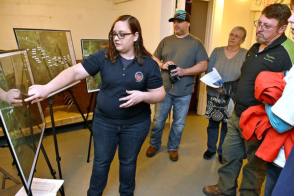 (Brad Davis/The Register-Herald) EPA On-Scene Coordinator Melissa Linden uses aerial maps of Minden to show residents their work so far in investigating the presence of PCB's in the town during the second day of public meetings Saturday morning at New Beginning Apostolic Church.