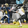 Shady Spring's Isaiah Valentine (44) tries to out run Liberty's Shawn Pennington (12) during their high school football game Friday in Shady Spring. (Chris Jackson/The Register-Herald)