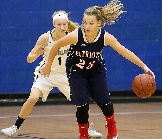 (Brad Davis/The Register-Herald) Independence's MaKenzie Holley moves along the perimeter as Nicholas County's Josie Chapman defends Friday night in Summersville.