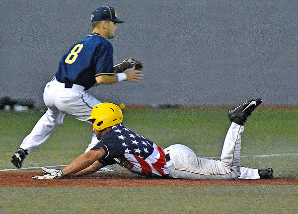 (Brad Davis/The Register-Herald) Miners baserunner Frankie Jezioro dives into 3rd base for a triple well before the throw gets to Lafayette infielder Kevin Raisbeck during the 6th inning Saturday night at Linda K. Epling Stadium.