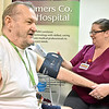 (Brad Davis/The Register-Herald) Hinton resident Leroy Cole gets a quick blood pressure check from Summers County ARH medical assistant Susan Dickenson during the Brothers & Sisters in Health event Thursday afternoon at First Presbyterian Church in Hinton. The event, sponsored by the church, Summers County ARH and West Virginians for Affordable Health Care, provided medical services to the public free of charge.