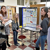 (Brad Davis/The Register-Herald) Independence Middle School students (from right) Emily Pierce, Kasey Burgess, Kennedy Blair and Sophia Raines present their project on King Tutankhamun to judge Lisa Hinkle during the Raleigh County Social Studies Fair Saturday morning at Woodrow Wilson High School. Caitlin Morgan, another student who worked with them on the project was unable to attend.