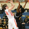 (Brad Davis/The Register-Herald) Summers County's Logan Jones drives to the basket as Mount View's Elijah Collier defends Wednesday night in Hinton.