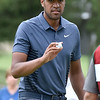 (Brad Davis/The Register-Herald) Tony Finau waves to the crowd on no. 11 during opening round action of the Military Tribute at The Greenbrier Thursday afternoon in White Sulphur Springs.