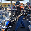 "(Brad Davis/The Register-Herald) U.S. Senator Joe Manchin hops back onto his bike after quick stop for fuel at the Tamarack Travel Center in Beckley Sunday morning, the first of 12 scheduled stops along a statewide motorcycle tour dubbed the ""Take Me Home"" ride. Their journey began at Charleston's Cultural Center, stopped first in Beckley then headed south towards Lewisburg, Marlinton, Elkins and Romney before capping the first of the two-day ride in Martinsburg. Today, the senator and anyone who decided to join the ride along the way will roll through Morgantown, Fairmont and Bridgeport before ending the ride and his mid-term election campaign back in Charleston."