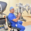 "(Brad Davis/The Register-Herald) Dr. Scott Killmer, a surgeon at Raleigh General Hospital, demonstrates how the da Vinci robotic surgical system, a.k.a. ""The Robot"" works during a Register-Herald visit to the hospital Friday afternoon. During a procedure, Dr. Killmer will control the robot from the station at left, sort of like a video game. He just completed his 500th surgery using the da Vinci system."