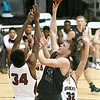 (Brad Davis/The Register-Herald) Wyoming East's Jacob Bishop drives to the basket as Woodrow Wilson's Jonah Stevens (#34) and Hunter Fansler defend during the Little General Battle for the Armory Tournament Friday night at Beckley-Raleigh County Convention Center.