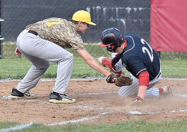 (Brad Davis/The Register-Herald) Greater Beckley Christian baserunner Andrew Patterson avoids the tag from Mount View pitcher Cody Muncy to score after a passed ball Wednesday evening at Park Middle School.