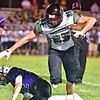 (Brad Davis/The Register-Herald) Wyoming East receiver Andrew Shrewsbury trucks though James Monroe defender Monroe Mohler after making a catch Friday night in Lindside.