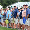 Spectators watch Joaquin Niemann hit his tee shot on the par 3, 18th green during the first round of, A Military Tribute at The Greenbrier golf tournament.<br /> (Rick Barbero/The Register-Herald)