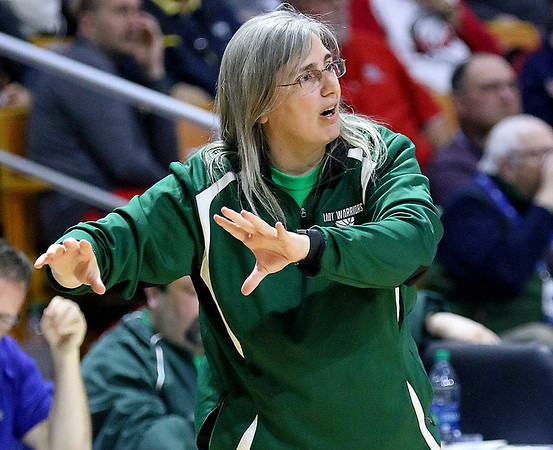 (Brad Davis/The Register-Herald) Wyoming East coach Angie Boninsegna instructs her team against Wayne Friday morning at the Charleston Civic Center.